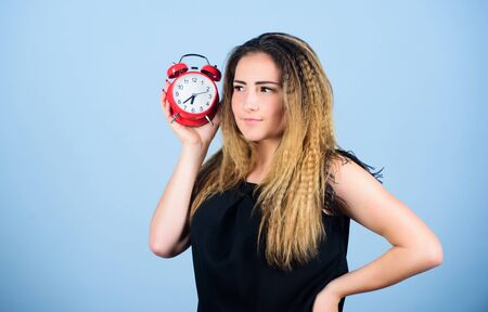 It is time. Few minutes. Time management. Punctuality and discipline. Woman hold red alarm clock. Counting time till deadline. Pretty girl managing her time. Overwork or being late. Timing issues