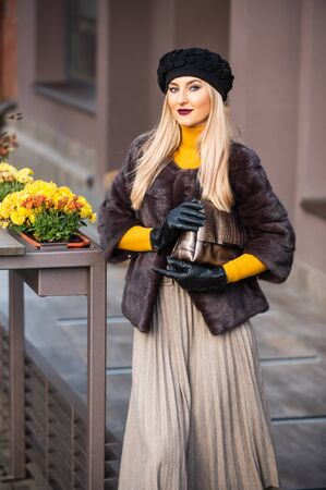 French style outfit. Gorgeous model. Beautiful winter outfit. Chic and trendy. Matching different textures outfit. Fashion and beauty. Autumn outfit. Elegant woman wear fur coat. Vogue concept