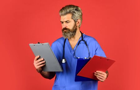 Medical nurse hold folder. pediatric healthcare. hospital or clinic. profession medicine staff. physician doctor with stethoscope and clipboard. therapist writing prescription Stock Photo
