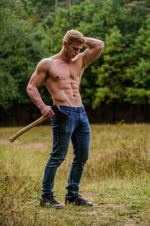 Sexy macho bare torso. Handsome shirtless man muscular body. Muscular athlete in forest. Sport and fitness. Muscular body. Surviving in wild nature. Brutality is sexy. Strength and power concept