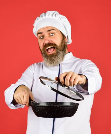 for preparing food. Bearded man cooking in kitchen. culinary and cuisine. Kitchen utensils. Healthy food cooking. cooking tasty dish. bearded man hold frying pan. Cooking in pot. selective focus