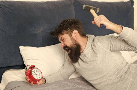 Catch up on missed sleep during weekend. Morning awakening. Stages of sleep. Man awake unhappy with alarm clock ringing. Although you are asleep you may wake up feeling like did not sleep at all.