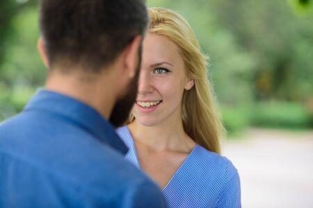 First meet of strangers, girl looks at bearded man