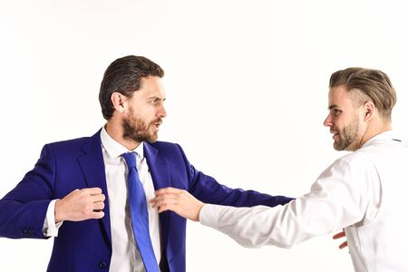 Boss and employee with aggressive expression fight. Business conflict concept.