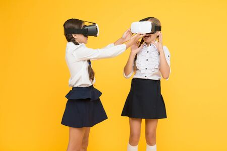 Experiences communicate and manage projects.Kids use modern VR technology. Virtual reality. VR headset. Future education. Children schoolgirls wear wireless VR glasses. Exploring augmented reality.