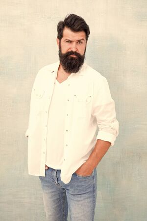 Facial care. bearded man radiate masculinity. handsome hipster jeans. male fashion beauty. Masculinity concept. Summer season fashion trend. brutal macho gray background. Male temper brutality