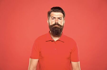 Hiring barber. Barber career. Barber salon. Man bearded hipster with long beard and mustache on red background. Hairstyle is kind of art. Well groomed hipster. Barbershop concept. Facial hair care