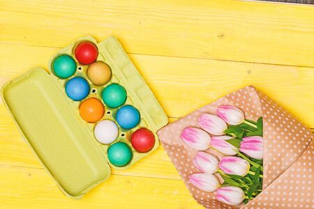 Happy easter. Spring holiday. Holiday celebration, preparation. Tulip flower bouquet. Healthy and happy holiday. painted eggs in egg tray. Egg hunt. Easter vibes.