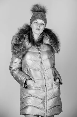 Faux fur. Fashion girl winter clothes. Fashion coat and hat. Fashion trend. Warming up. Casual winter jacket slightly more stylish and have more comfort features such as larger hood fur trim on hood Stock fotó