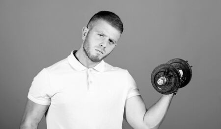 Strong muscles and power. Muscular and strong guy exercising. fit your body and lose weight. Sport dumbbell equipment. Weight lifting. man workout with barbell. Healthy lifestyle concept 写真素材