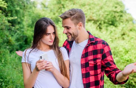 mistrust concept. man pry phone of girl in park. Jealousy. navigator search. romantic date online. personal space concept. Got lost. couple use smartphone outdoor. couple in love. Blogging concept