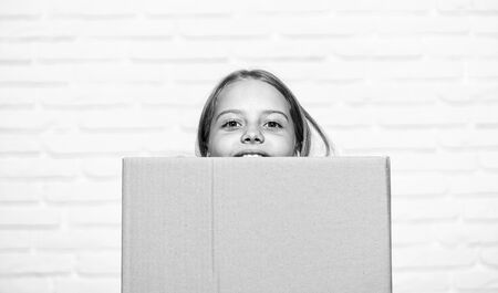 carry on. small girl child. little girl with box. moving to new apartment. perfect purchase. moving concept. move to new house. rent concept. repair annd relocate. happy childhood. copy space