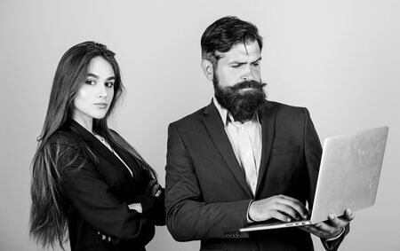 Discussing progress. Man bearded manager show financial report laptop. Woman and guy colleague working together. Business plan. Business lady and director or boss surfing internet. Business meeting Standard-Bild