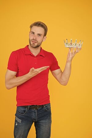 arrogant and self confident man. live in luxury. prom king actually. definitely the best. party king. imagine he is hub of universe. being egoistic. reward for your success. happy man with crown Stock Photo