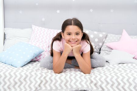Little girl in pajamas get ready for bedtime. Relax and ease the transition to sleep. Bedtime concept. Calming activity for kids. Ways to relax before bedtime. Relaxation Exercises for Falling Asleep.