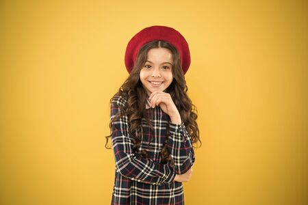 Pure beauty. Kid little cute fashion girl posing with long hair and hat. Fashion girl. Fashionable accessory. Teenage fashion. French fashion. Child small girl happy smiling baby. Happy childhood