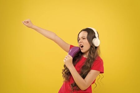 Sing lyrics. Little girl enjoying favorite music. Catch the rhythm. Kid listening music headphones. Entertainment and fun. Whole musical world in her ears. Child teen enjoy music playing in earphones