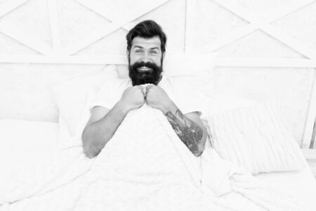 Man handsome guy in bed. Enough amount sleep every night. Tips sleep better. Bearded man relaxing on pillow. Circadian rhythm is natural internal process that regulates sleep wake cycle. Perfect rest Imagens