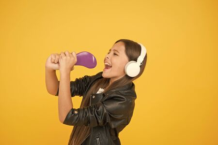 kid in headset. small girl sing favorite song. imagine you are pop star. singing karaoke. singer leather jacket. child listen rock music. school radio dj. hipster urban style girl