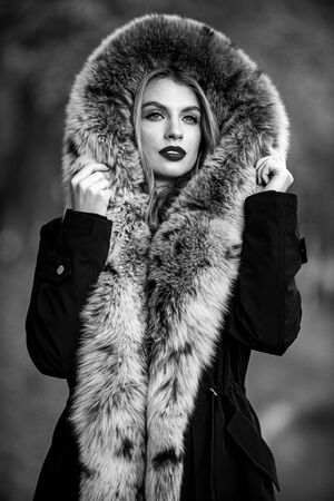 trendy winter look. No Compromise on Comfort. Man-made fur is prone to shedding. fake fur from a reputable brand. elegant girl walk in autumn park. beauty and fashion. woman wear fur coat