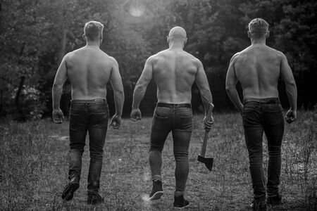 Brutal macho style. Strong men nature background. Inspiring training harder. Group muscular men with axe. Athletic man use ax. Wild masculinity. Strength and perseverance. Men with muscular torso Banque d'images