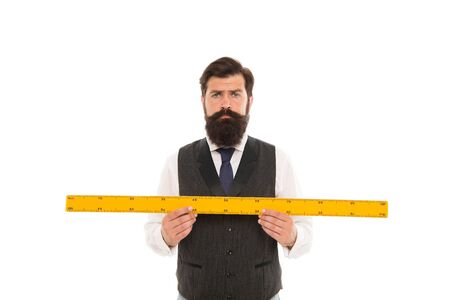 Measuring a line. back to school. bearded man hold ruler isolated on white. Teacher holding metric ruler. preparing for maths and geometry lesson. mature man with big measuring instrument Banque d'images