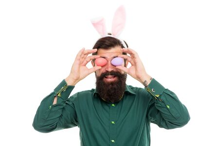 Here comes Easter rabbit. Bunny rabbit hold eggs as glasses. Bearded man wear rabbit costume. Decorating eggs. New life. Spring and fertility. Holiday celebration. Easter days rabbit.