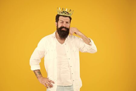 Bearded man dreaming. Love yourself. Holiday carnival celebration. brutal and handsome prince yellow background. King of party. Egoist selfish man. Narcissistic person. Superiority complex