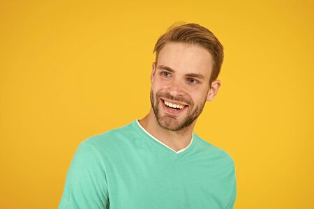 as happy as i wish. just feel the happiness. handsome guy in good mood. male facial care. have perfect look. sexy man beard yellow background. unshaven man express positivity. he has stylish bristle Banco de Imagens