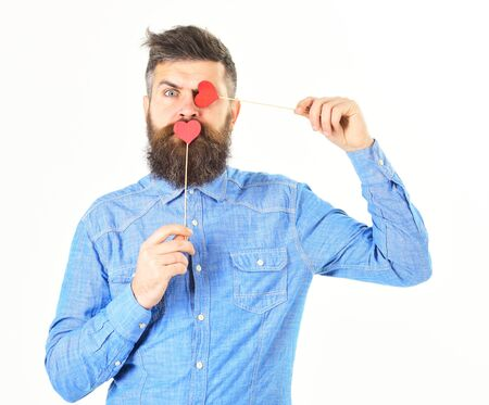 Hipster with paper red hearts and surprised face.