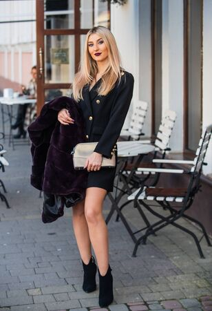 Lifestyle model. Youth lifestyle. Vivid lifestyle shot. Elegant woman wear dress. Luxury clothing material. Lady walk street cafe terrace background. Weekend walk in city center. Pretty woman walking
