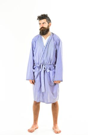 Badly slept concept. Guy stand straight in bathrobe,