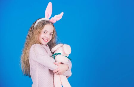 Egg hunt. Family holiday. Spring party. Little girl with hare toy. Happy easter. Child in rabbit bunny ears. copy space.h appy small child. small child with toy. Child with small toy hare. Happy day