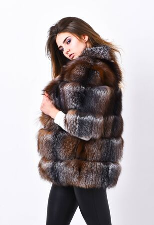 Woman makeup and hairstyle posing mink or sable fur coat. Fur fashion concept. Winter elite luxury clothes. Female brown fur coat. Fur store model enjoy warm in soft fluffy coat with collar