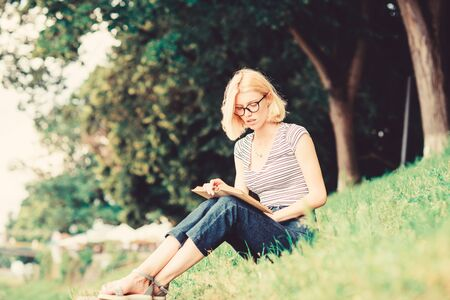 reading is my hobby. Summer study. woman in park reading book. inspired by novel author. interesting story. Relax and get new information. student girl with book. Schoolgirl having literature lesson Reklamní fotografie