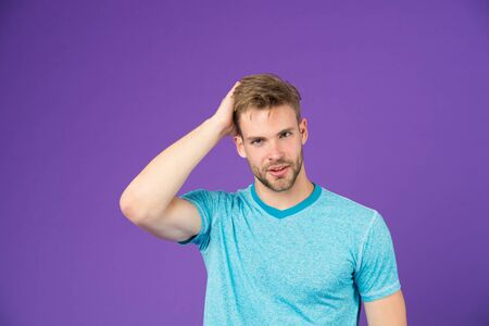 Beauty care advice sportsman. Man with bristle satisfied face in sporty wear violet background. Man with beard unshaven guy enjoy soft hair. Guy bearded attractive touch soft hair. Male beauty tips