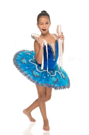 There are many paths to ballet. Child happy holds ballet shoes important attribute excellent ballerina. Start career classic dances program. Girl ballerina holds pointe shoes in hand white background