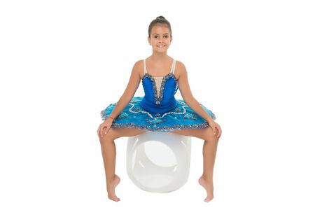 Child flexible pupil practice stretching. Child tender dancer look gorgeous fancy leotard. Dream of every girl to become famous ballet dancer. Kid blue dress ballet skirt white background isolated
