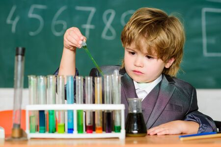Boy test tubes liquids chemistry. Chemical analysis. Knowledge day. Kid study chemistry. Biotechnology and pharmacy. Genius pupil. Education concept. Experimenting with chemistry. Talented scientist 版權商用圖片