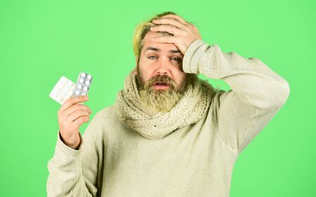 Bacteria invades body. Virus treatment. Sick man hold tablets. Virus pneumonia. Bearded hipster messy hairstyle. Buy medicines. Virus fever. Vitamin supplements. Immune system fight infections Foto de archivo