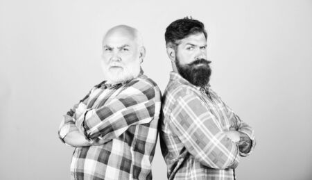 relatives. two bearded men senior and mature. youth vs old age compare. retirement. barbershop and hairdresser salon. father and son family. generational conflict. male beard care. checkered fashion