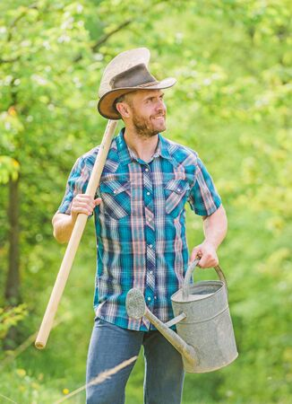farming and agriculture cultivation. Garden equipment. Eco farm. Harvest. muscular ranch man in cowboy hat. happy earth day. Eco living. sexy farmer hold shovel and watering can. Like what you do