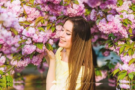 natural summer beauty. skincare and spa. Natural cosmetics for skin. blossom smell, allergy. woman in spring flower bloom. girl in cherry flower. Sakura tree blooming. Great pleasure