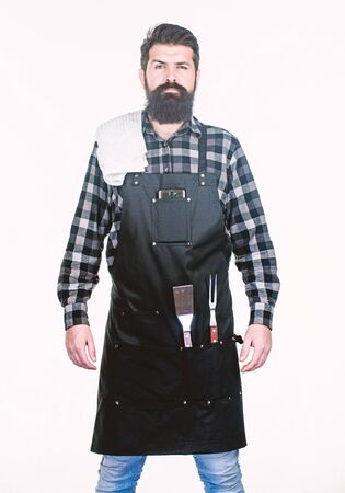 Planning a BBQ. Professional hipster cook. Brutal hipster wearing grilling apron. Bearded hipster ready for preparing barbeque foods. Chef hipster