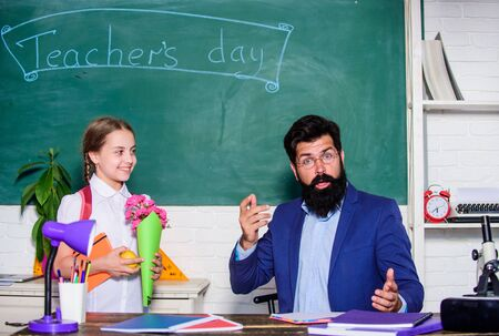 spring. back to school. Happy teachers day. small school girl kid with flower bouquet. knowledge day is 1 september. teachers day. Daugghter and father with flowers. flower present for best teacher