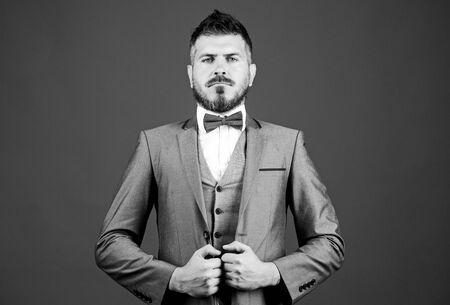 serious event manager. business in modern life. mature illusionist. Bride groom ready for wedding. bearded man in formal suit. businessman with beard in bow tie. esthete. stylish art director Фото со стока