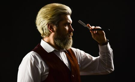 hairdresser or barber scissors. haircut by hairdresser. Portrait of stylish man beard. holding equipment in hand. Getting perfect shape. getting beard haircut by hairdresser at barbershop