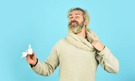 happy hipster presenting best remedy. Nasal drops plastic bottle. pandemic concept. man treat runny nose with nasal spray. free your stuffy nose. no addiction to medicals. coronavirus from china