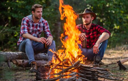 warm and cosy. family camping. hiking adventure. picnic in tourism camp. happy men brothers. friends relaxing in park together. drink beer at picnic. campfire life story. spend free time together