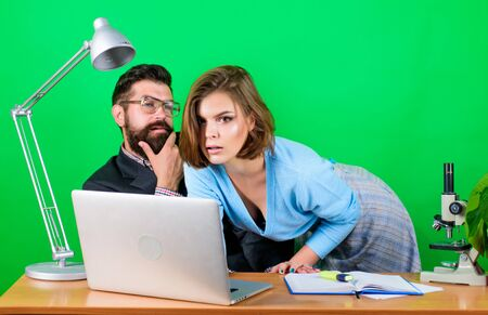 Banned relations concept. Private lesson. Flirting with teacher. Student sensual girl and experienced teacher. Show him how to use laptop. Hot student. Mature teacher and attractive female Archivio Fotografico